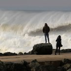 People look big waves at the beach of Anglet, southwestern France. <span class=