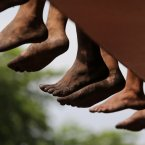 Barefoot Filipino Catholic devotees rest during the annual procession of the Black Nazarene to celebrate its feast day in Manila, Philippines.  <span class=