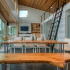 The steel stairs save space and lead to a small 198-square-foot loft area that has a guest bedroom.