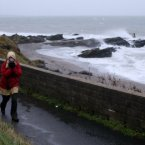 A lone walker braves the bad weather for a New Year's Day walk along the Coast Road, Portmarnock.<span class=