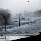 Water covers the coastal roads at Clevelys near Blackpool on 6 January. <span class=