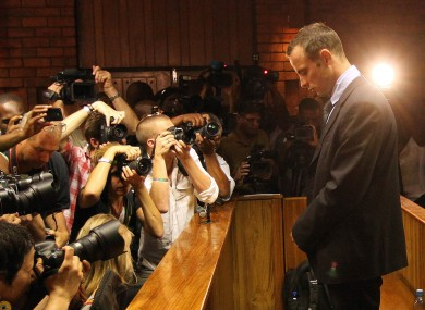 Oscar Pistorius faces the press from the dock.