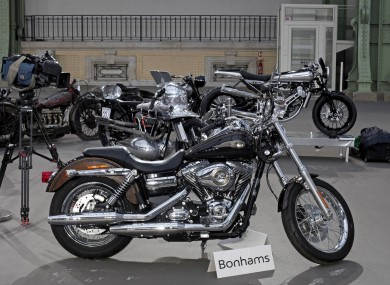 The 2013 Harley DavidsonSuper Glide Custom A 1,585cc Harley-Davidson Dyna Super Glide, donated to Pope Francis last year and signed by him on its tank, is displayed ahead of Bonham's sale of vintage and classic cars, at the Grand Palais in Paris. The bike was sold at auction to help raise funds for a soup kitchen and hostel for the homeless in Rome.
