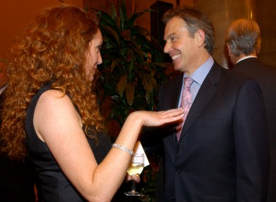 British Prime Minister, Tony Blair speaks to Rebekah Brooks, then Sun editor in 2004.