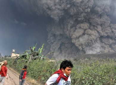 People prepare to flee during the eruption.