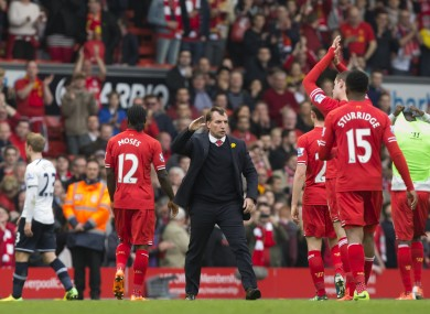 Brendan Rodgers celebrates with his Liverpool players yesterday.