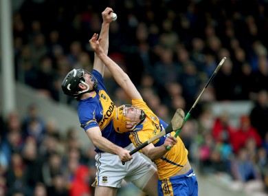 Tipperary's Conor O'Mahony and Clare's Peter Duggan battle for possession.