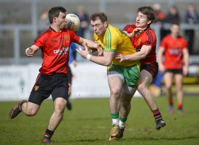 Down's Daniel McCartan with Owen Costello and Donegal's Dermot Molloy.