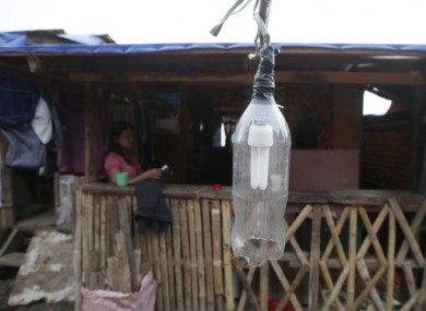 Typhoon survivors rebuild their homes as they recover from Typhoon Haiyan.
