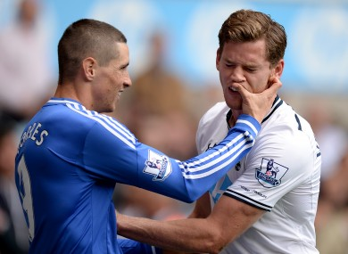 Fernando Torres pokes Spurs defender Jan Vertonghen back in September.