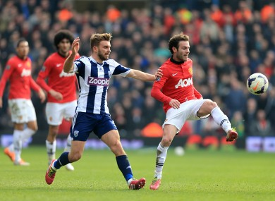 Manchester United's Juan Mata (right) and West Bromwich Albion's James Morrison (left) battle for the ball.
