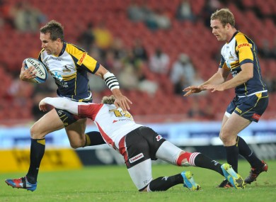 Smith [carrying the ball] in Brumbies' colours in 2012.