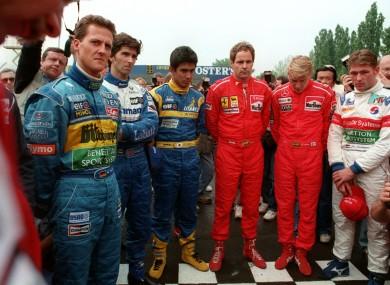 F1 drivers hold a minutes silence for Simtek driver, Roland Ratzenberger.