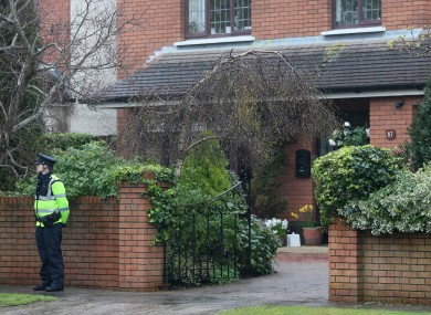 A Garda stands on duty outside the Minister for Justice, Alan Shatter's, house in South Dublin this afternoon.