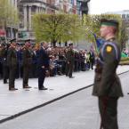 Taoiseach Enda Kenny stands to attention.<span class=