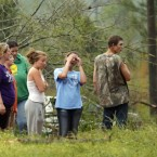 Residents of Four Corners look at the damage left by a tornado that hit their small community about 20 miles from Louisville.<span class=