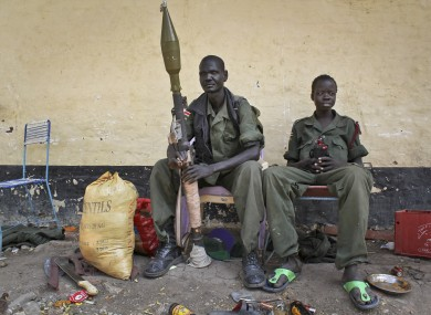 Rebels sit in the now-emptied hospital in Malakal.