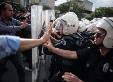 Riot police try to stop protesters who were attacking the offices of Prime Minister Recep Tayyip Erdogan's Justice and Development Party, in Soma, Turkey,.