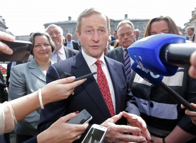 Enda Kenny speaking to reporters at Leinster House today