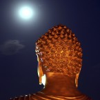 A full moon is seen behind a Buddha statue lit up on the eve of Buddha Jayanti festival at a monastery in Bhopal, India.  The festival marks Buddha's birth, enlightenment and death.<span class=