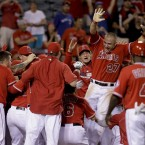Los Angeles Angels' Mike Trout, (27), celebrates his three-run walk off home run against the Rays.<span class=