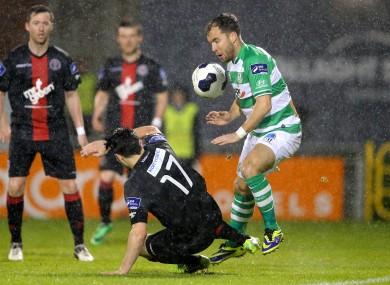 Sean O'Connor avoids Bohs' Anto Murphy's sliding tackle.
