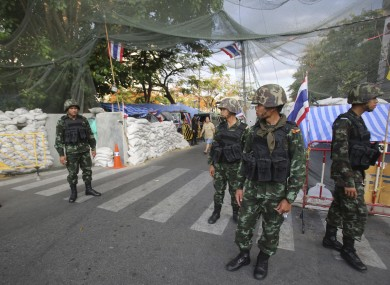 Thai soldiers guard outside an area where anti-government protesters occupy today.
