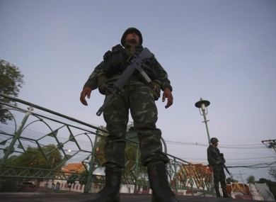 Thai soldiers guard in front of Marble Temple after soldiers staged a coup today.