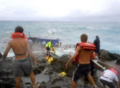 File photo of people trying to rescue the passengers on the capsized vessel at Christmas Island on 15 December 2010