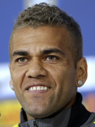 Brazil's Dani Alves looks on during a news conference at the Granja Comary training centre in Teresopolis, Brazil.