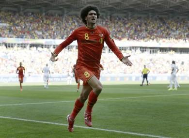 Marouane Fellaini celebrates his equalising goal as Belgium came from behind today.