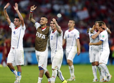 Chile's players celebrate the win over Spain.