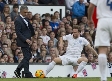 Singer Olly Murs, bottom right, playing for an England team is tripped up by Jose Mourinho manager of a Rest of the World team.