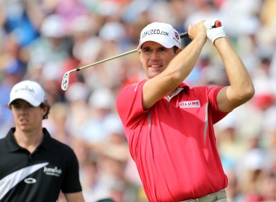 Harrington with McIlroy in the background.