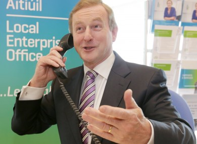 Taoiseach Enda Kenny on the phone, presumably to investors.