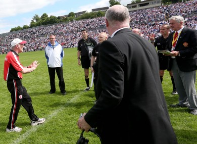 Mickey Harte confronts referee Eddie Kinsella at the end of the game.