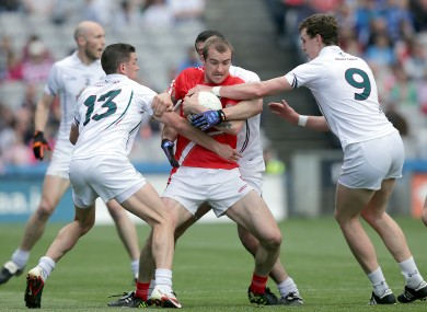 Paddy Keenan surrounded by Kildare attackers.