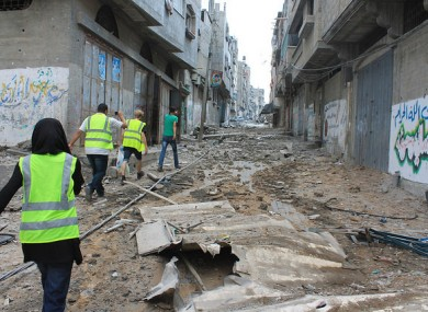 Moments before he is shot dead, Salem Khaleel Shamaly (in green t-shirt) leads a group to find his family in Gaza city.