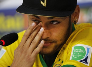 Brazils Neymar Wipes A Tear During A Press Conference At The Granja Comary Training Center In
