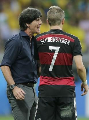 Germany's head coach Joachim Loew speaks to Bastian Schweinsteiger duyring last night's game.