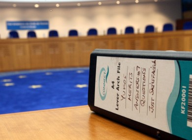 A file lays on a desk at the European Court of Human Rights ahead of an hearing on the Yukos versus Russia case.