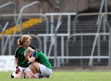 Rachel Corrigan and Donna Barry show their dejection at the final whistle in Páirc Tailteann.