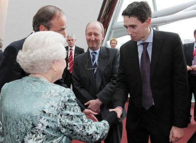 Simon Harris and the Queen, during her 2011 State visit.