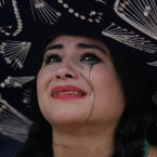 A Mexico soccer fan cries after her team was defeat on the World Cup round of 16 match against Netherlands. <span class=