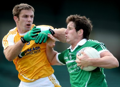 Antrim's Tony Scullion and Padraig Browne of Limerick.