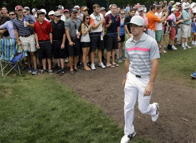 Rory McIlroy walks past the gallery on the eighth hole during the final round of play.