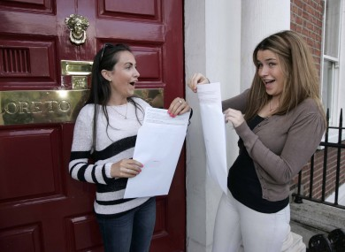 Caoimhe Cleere, left, from Terenure who want to study business at UCD and Anne Rose Fullen who want to study business and language at an undecided university collect their Leaving Cert results.
