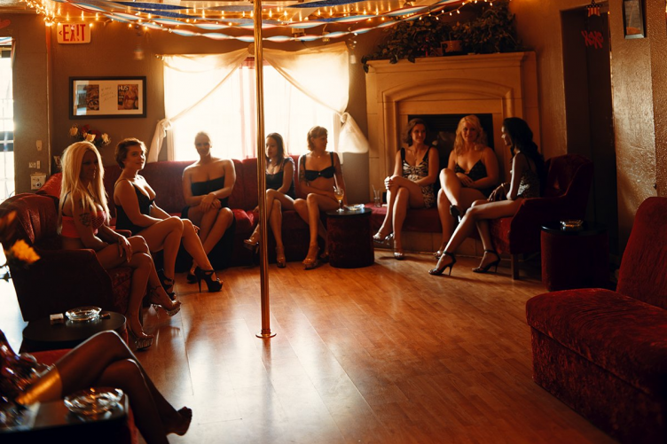 Inside the brothels: 19 striking photos of owners, sex workers and their  clients