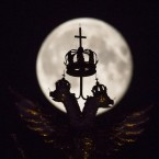 The supermoon rises behind the golden double-headed eagle, the National Emblem of the Russian Federation at Red Square in Moscow, Russia<span class=