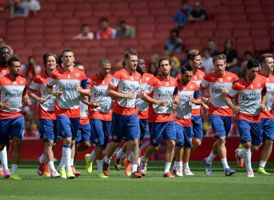 The Arsenal players warm up during the training session at the Emirates Stadium.